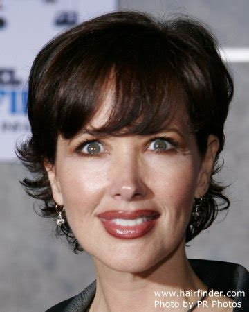 Janine Turner sporting short hair with layers springing up