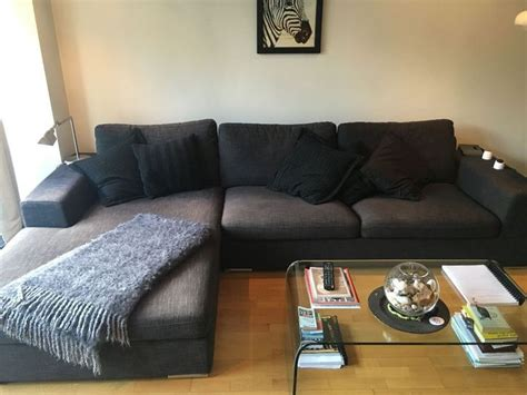 dark greyblack  shaped dwell couch earls court london