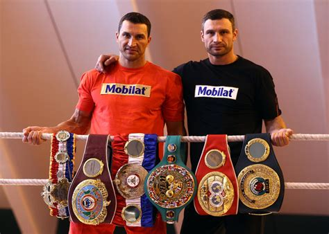 klitschko brothers who is better klitschko brothers show their chionship belts