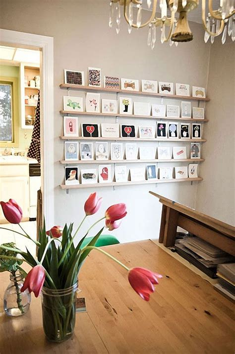 creative ways to hang posters 20 cool ideas to display unframed photo and postcards on