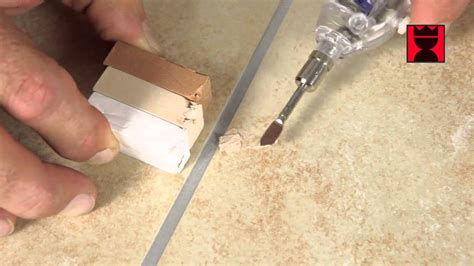 repair holes in floor or wall tiles