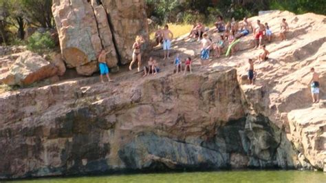 the boby pen burnat texas cliff jumpers at the devil s waterhole inks lake state