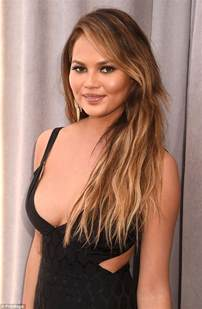 sizzling chrissy teigen flashes cleavage and leg in slinky black gown