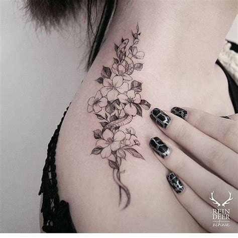 tattoo on shoulder top illustrative flower wreath on top of the right shoulder