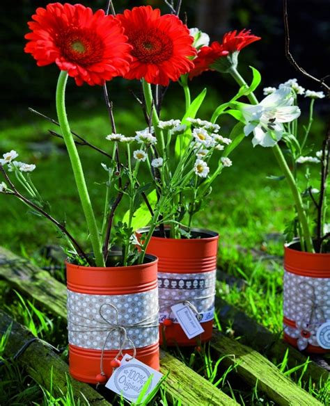 Tin Flower Vase by Awesome Ways To Upcycle Tin Cans In Your Garden