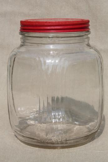 hoosier vintage glass jars  red painted metal lids