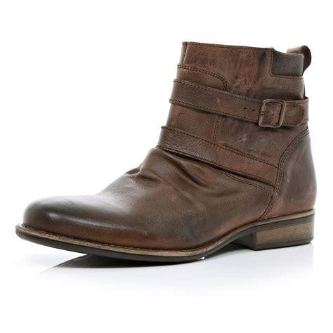 brown biker style boots river island brown distressed strap biker boots in brown