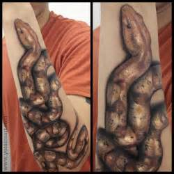 arm snake 3d tattoo by yomico art