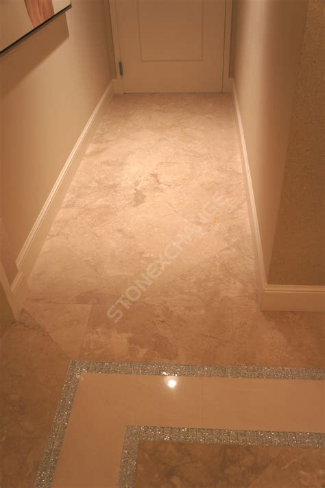 larger tiles make a small room appear how marble flooring can make a small space appear larger nalboor