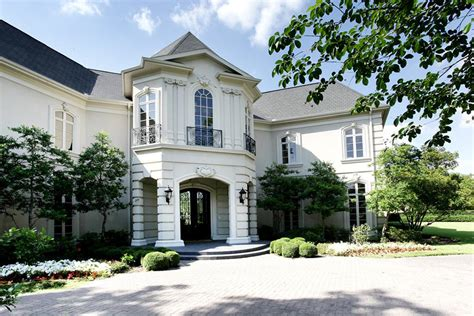 french chateau style home in stucco cast stone new country french cottage mediterranean exterior dc metro