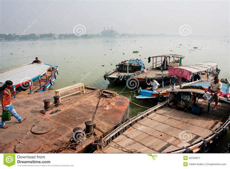 boat driving license in india boat drivers wait for the passengers at the old river dock