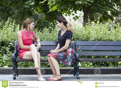 women bench young woman resting on a bench in the park stock image