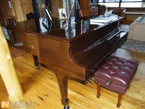 steinway grand piano with stool