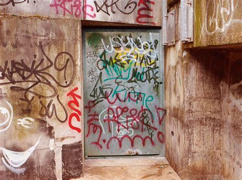 street artist paints  ugly graffiti    legible