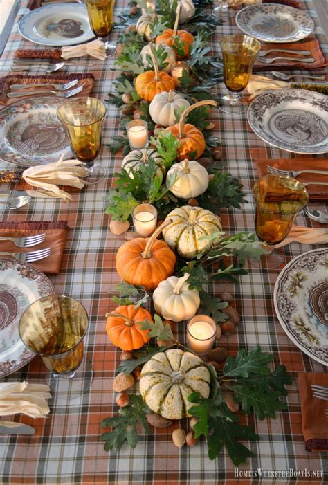 thanksgiving table with turkey a thanksgiving table with turkey plates plaid and pumpkin