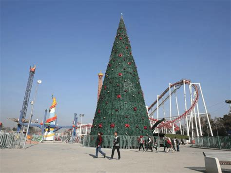 iraqis erect a 30 foot christmas tree in baghdad to