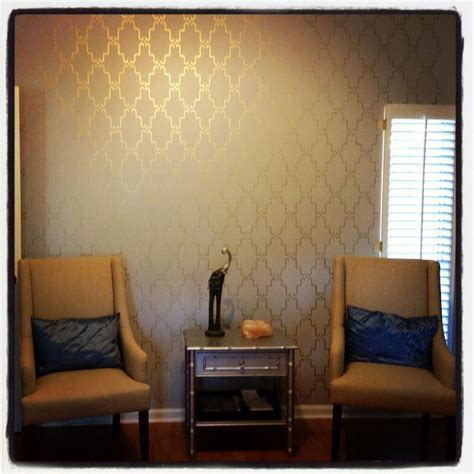 stenciled accent wall with metallic gold paint if i could do a coral wall with gold