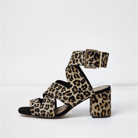 leopard sandals river island leopard wide fit crossover block heel sandals