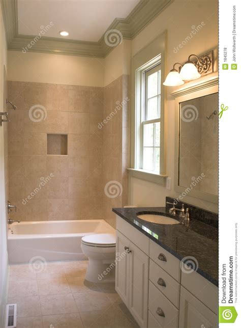 simple bathtub simple bathroom with tile and stone stock photo image of