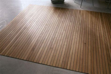 Floors And Decors by Roll Up Wooden Carpet Redefines Movable Floor Coverings