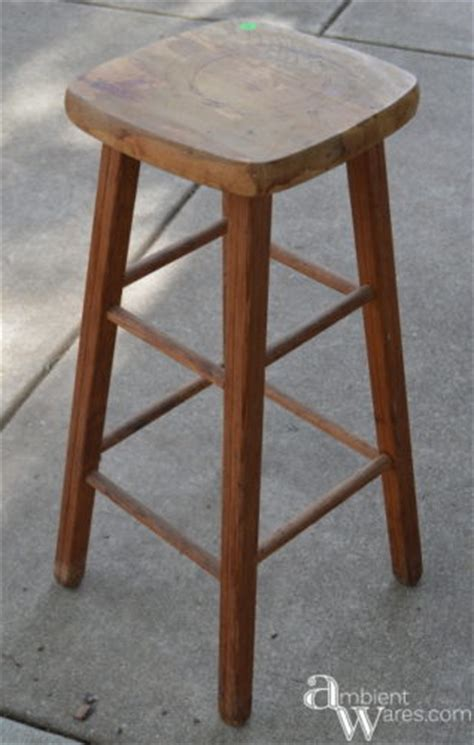 upside down bar stool repurposed stool to gift wrapping storage station
