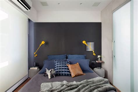 yellow accent wall bedroom small and refined contemporary apartment in rio de janeiro
