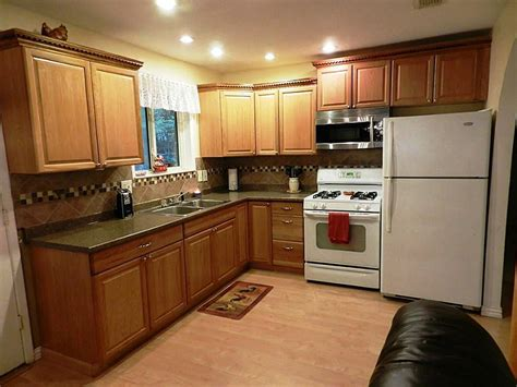 kitchen kitchen paint colors with oak cabinets and white appliances sloped ceiling staircase