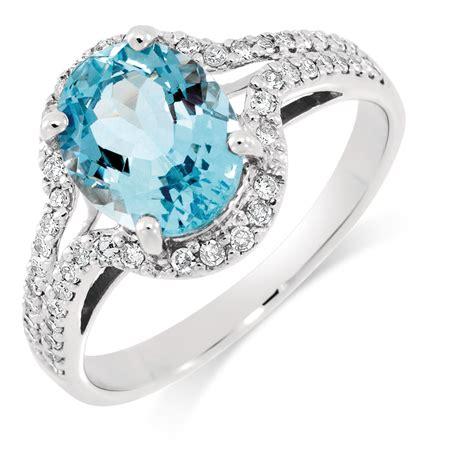 Ring with Aquamarine & 1/4 Carat TW of Diamonds in 10ct