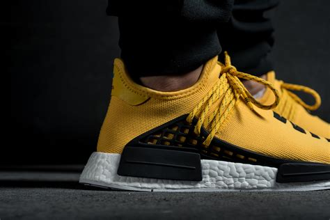 Adidas X Pharrell Nmd Human Race Orange the pharrell x adidas nmd human race debuts this weekend