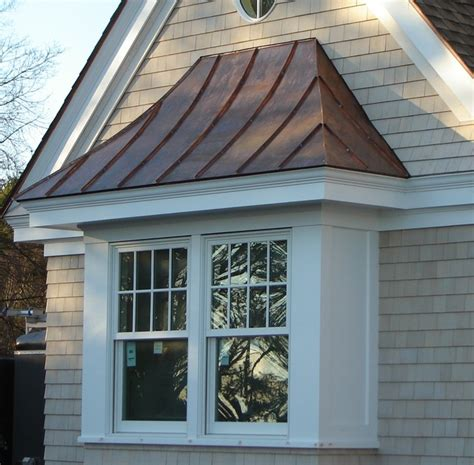 copper standing seam roof over window traditional