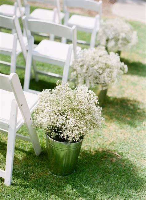 ceremony aisle lined with buckets of baby s breath