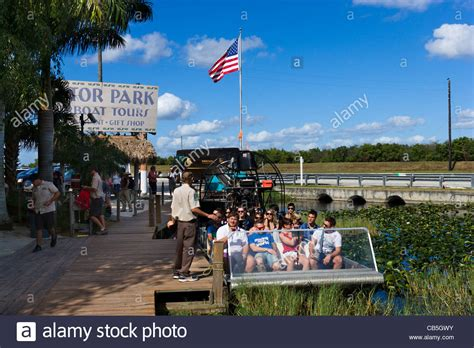 airboat gator park airboat alongside the dock at gator park airboat tours on