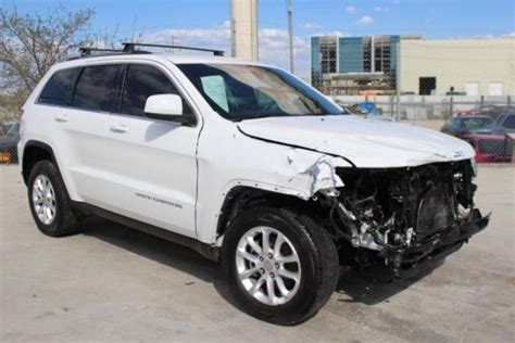 totaled jeep grand 2015 jeep grand cherokee laredo damaged repairable low
