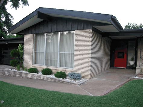 what is a mid century modern home white brick grey wood red door home pinterest