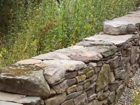 Dry Stack Rock Wall For The Front Circle Garden Garden Garden Rock Wall