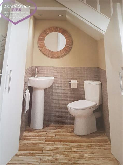 downstairs bathroom ideas downstairs under stairs toilet idea i like how the doors