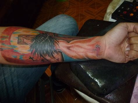 tattoo 3d cross 3d jesus cross on left forearm