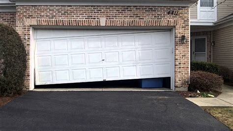 who fix garage doors a crooked garage door in lisle il 630 271 9343