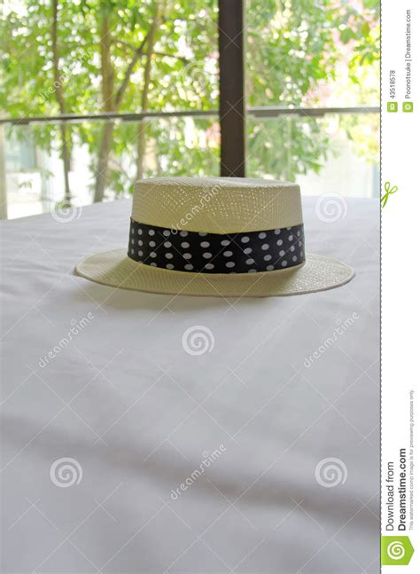hat on the bed straw hat on the bed stock photo image 43518578