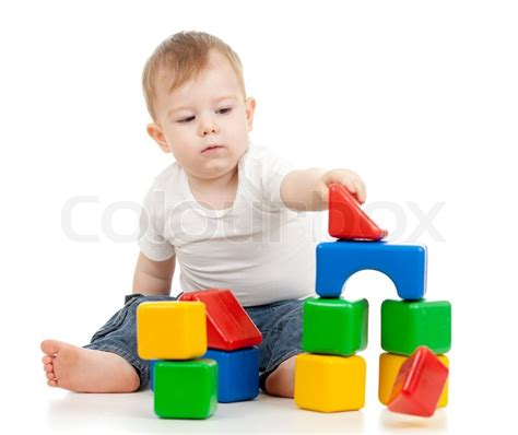 New Home Building Plans by Little Boy Playing With Building Blocks Stock Photo