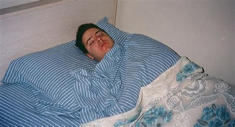 sleeping in my bed remix file man sleeping striped sheets jpg wikimedia commons
