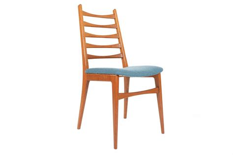set of six teak kofoed style ladder back dining chairs at