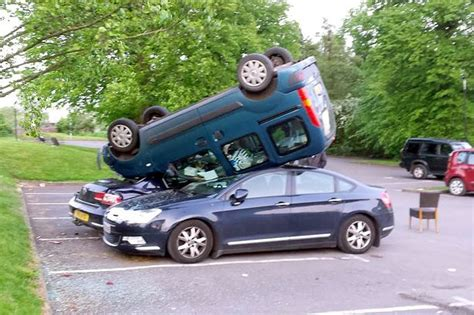 upside down boat house driver lands upside down on top of parked cars after hurtling down grass bank but