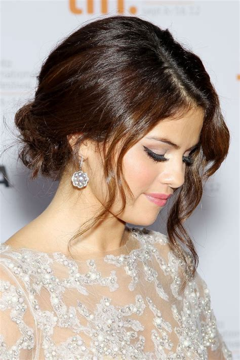 selena gomez wearing a elegant low bunchignon hairstyle 10 best valentine s day hairstyles 2017 pretty