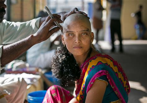 new indian women headshave these striking images show indian women shaving their