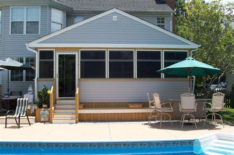Gorgeous Home Screened In Porch Design With Gable Roofing
