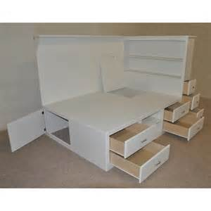white wooden bed with many storage drawers combined with