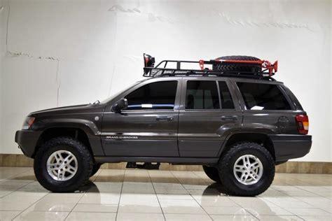 1j4gw48n24c404890 jeep crand laredo 4wd quadra