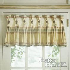 inverted box pleat valance tacked with bronze nail heads small box pleats with sashes 2 sewn into the pleats and