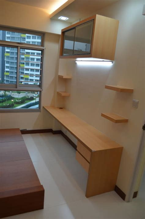 study table in living room modern design for hdb 3 room type apartment with modern zen bed frame tatami in punggol